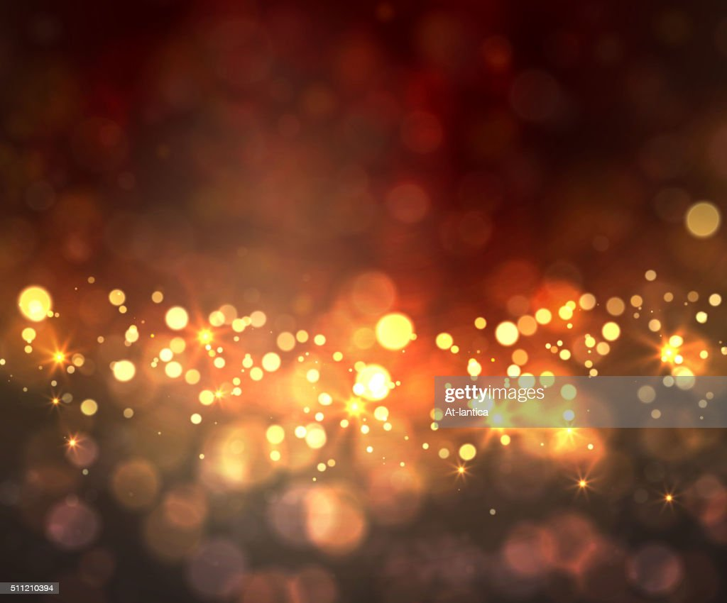 Festive light background with bokeh and stars