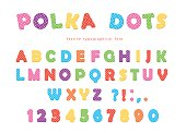 Festive polka dots font. Colorful ABC letters and numbers. Funny alphabet for kids. Isolated on white.