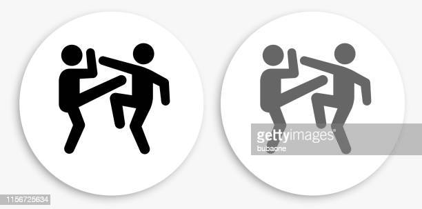 fighting black and white round icon - martial arts stock illustrations