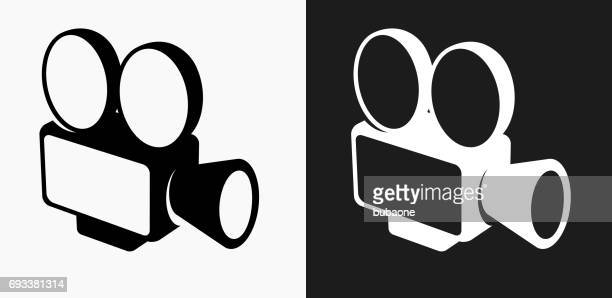 film camera icon on black and white vector backgrounds - film camera stock illustrations, clip art, cartoons, & icons