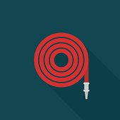 Fire hose icon with long shadow on blue background, flat design style