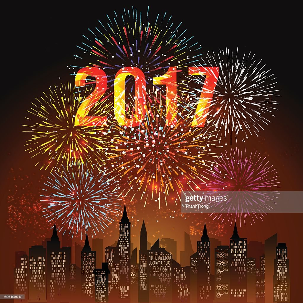 fireworks display for happy new year 2017 above the city