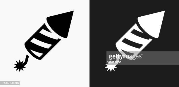 fireworks icon on black and white vector backgrounds - firework explosive material stock illustrations