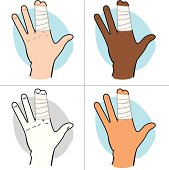 First Aid dressing with bandages on fingers ethnic