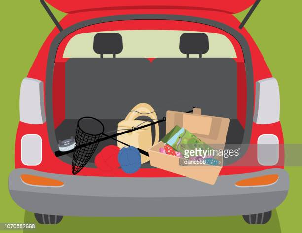 fishing tackle in the back of an suv - tree trunk stock illustrations