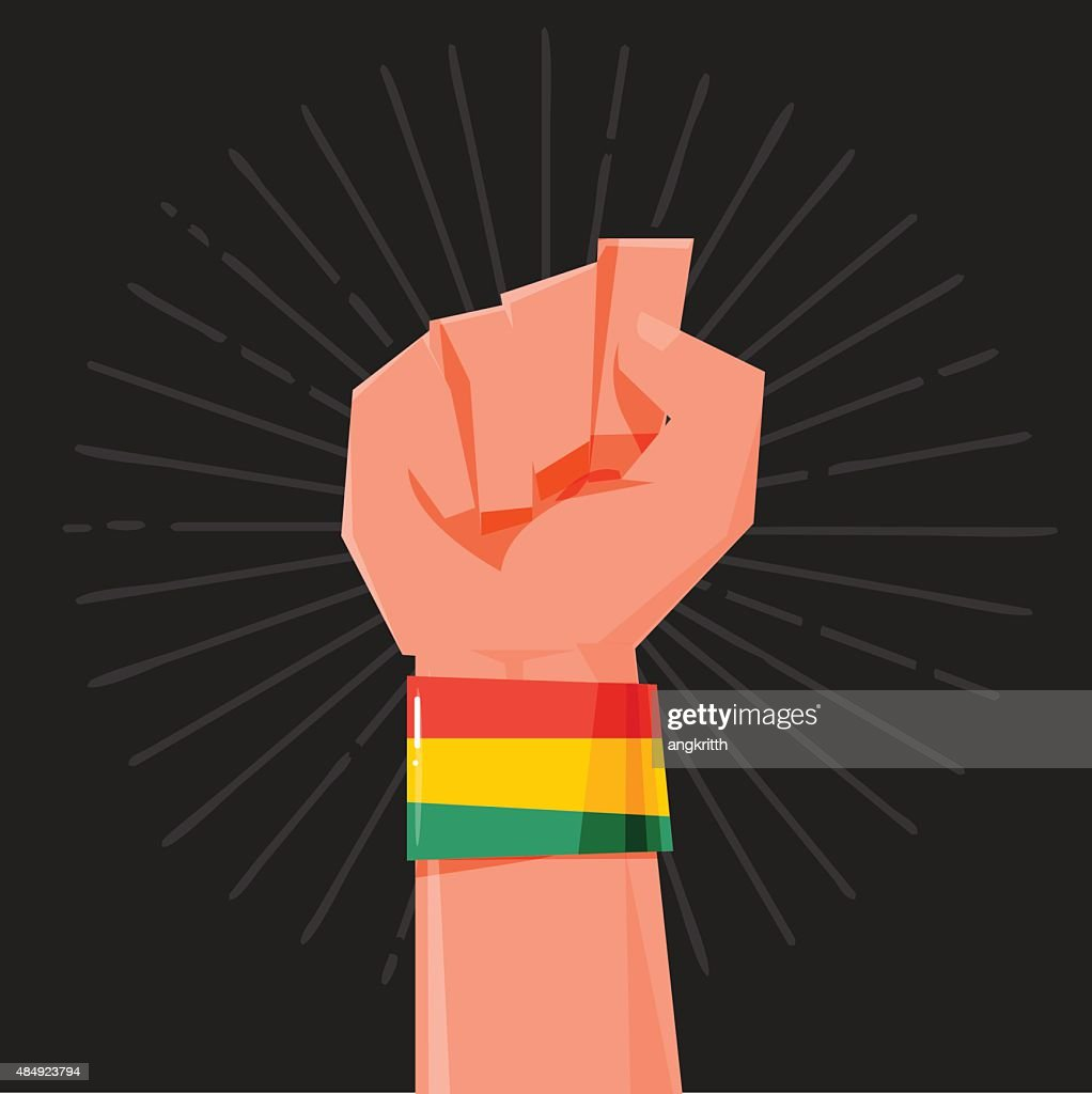 fist hand held high with Rasta style Bracelets. wristband. finan