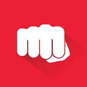 Fist icon isolated on red background. Vector illustration.