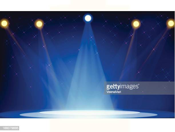 Five bright spotlights shining on an empty stage in blue hue