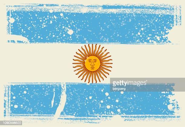 ilustraciones, imágenes clip art, dibujos animados e iconos de stock de bandera de argentina. vector ilustración con marco grunge - bandera argentina