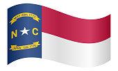 Flag of North Carolina waving on white background