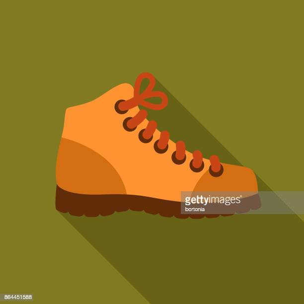 flat design camping hiking boots icon with side shadow - hiking boot stock illustrations