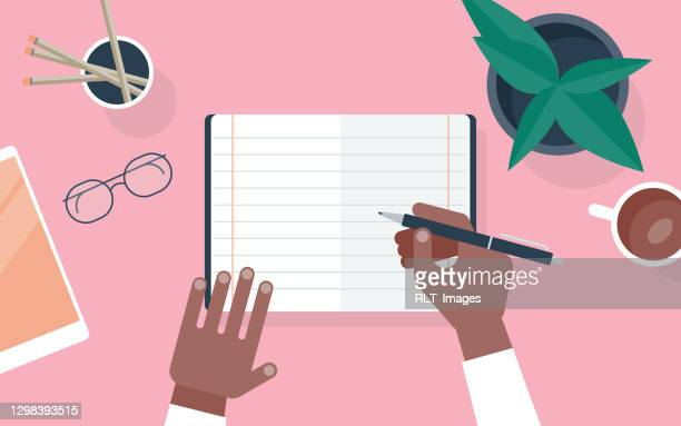 flat vector illustration of person writing in notebook at desk - diary stock illustrations
