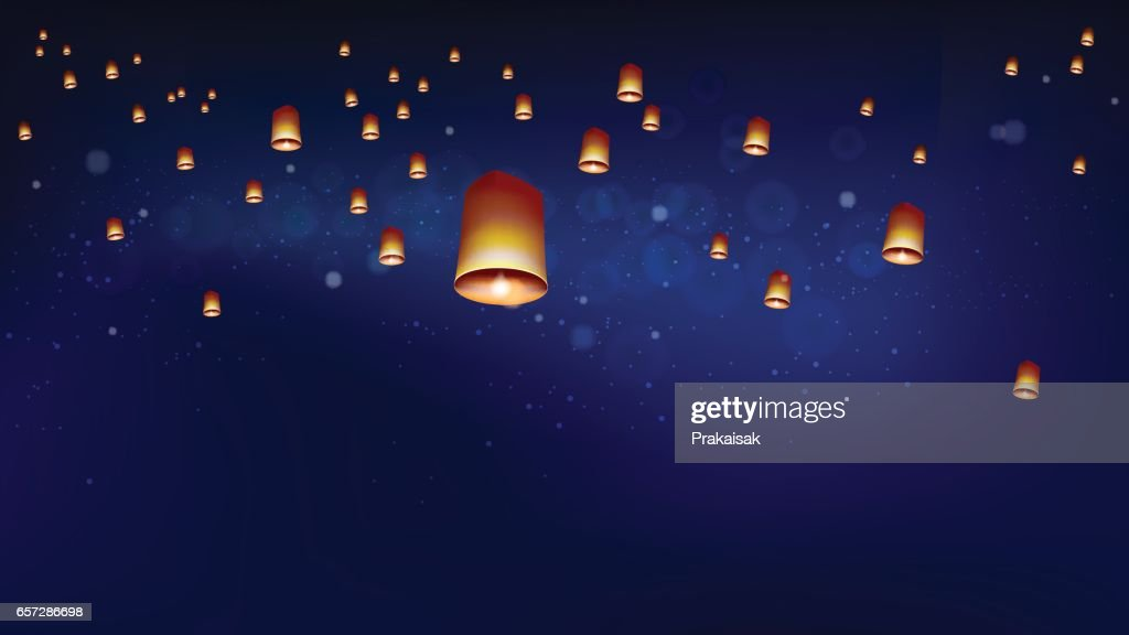 Floating lanterns into the night sky ceremony at North Thailand