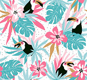 Floral background with tropical flowers, leaves and toucans. Vector seamless pattern for stylish fabric design.