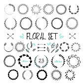 Floral collection of hand drawn doodles, arrows, branches, leaves and floral frames with text.