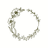 Floral monogram wreath with line art flowers and leaves.
