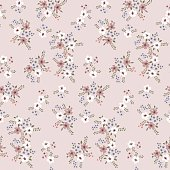 Floral seamless pattern of small flowers in pastel colors