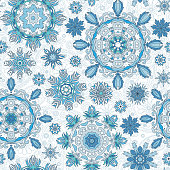 Floral seamless pattern with stylized snowflakes.