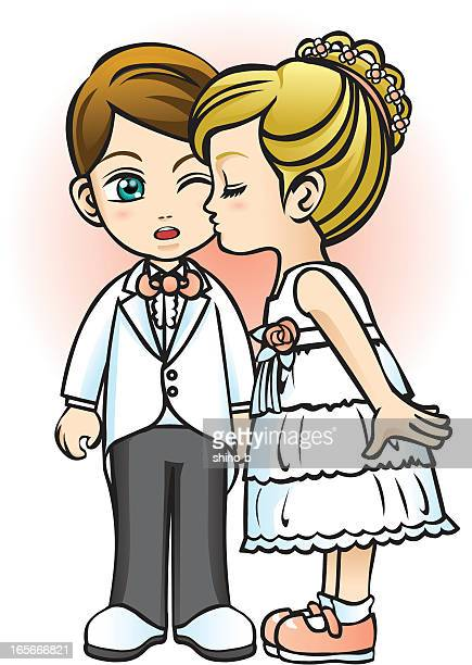 Flower girl kissing page boy