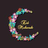 Flowers decorated moon for Eid Mubarak celebration.