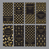 Flyers with patterns in gold and black.