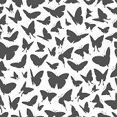 Flying butterflies silhouettes seamless pattern