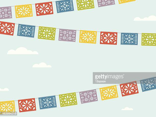 flying fiesta flags - mexican culture stock illustrations