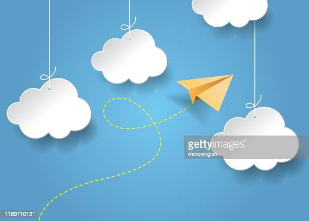 illustrazioni stock, clip art, cartoni animati e icone di tendenza di flying paper airplane. plane and clouds with shadow on blue background - aeroplano di carta