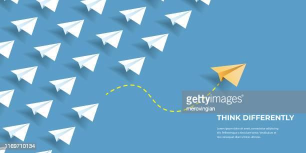 illustrazioni stock, clip art, cartoni animati e icone di tendenza di flying paper airplanes. think differently, leadership, trends, creative solution and unique way concept. be different. - aeroplano di carta