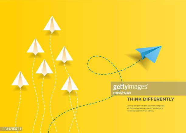 flying paper airplanes. think differently, leadership, trends, creative solution and unique way concept. be different. - individuality stock illustrations