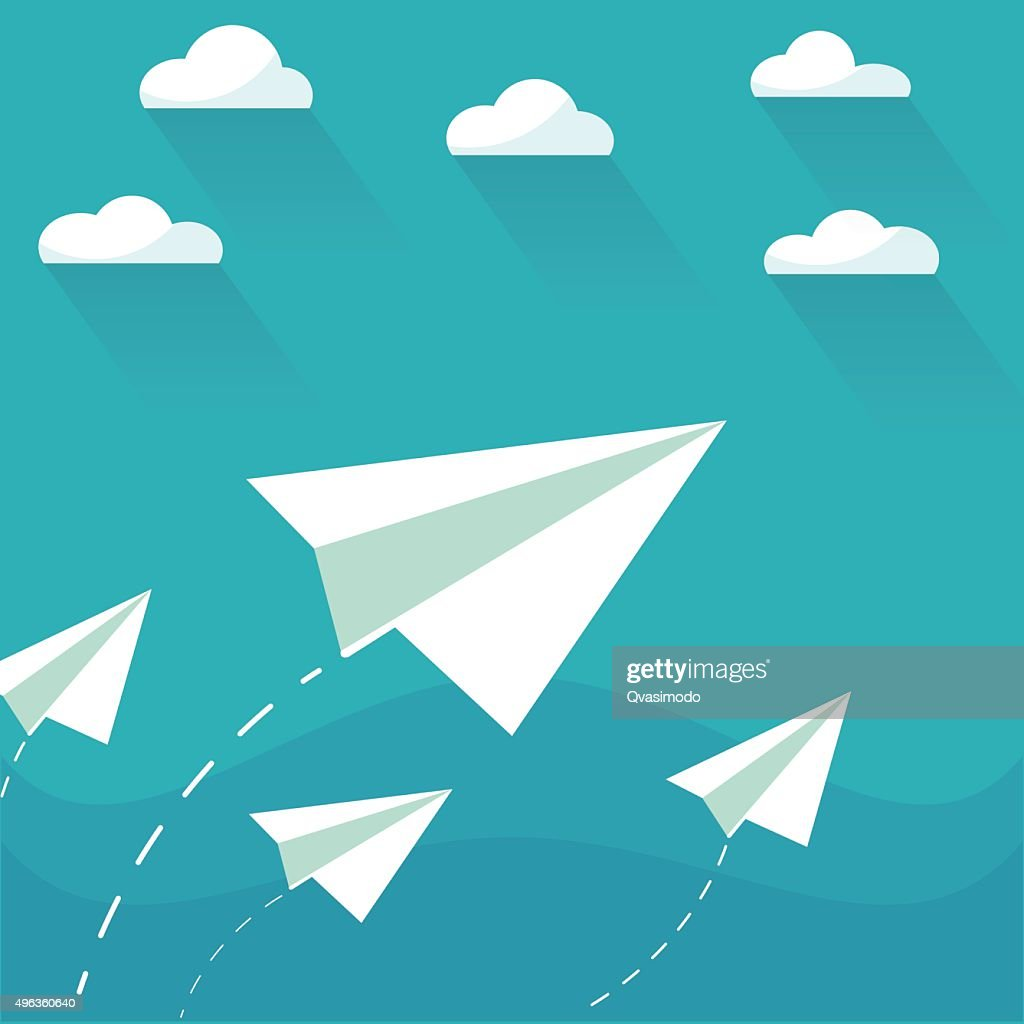 Flying paper planes on the blue sky with clouds