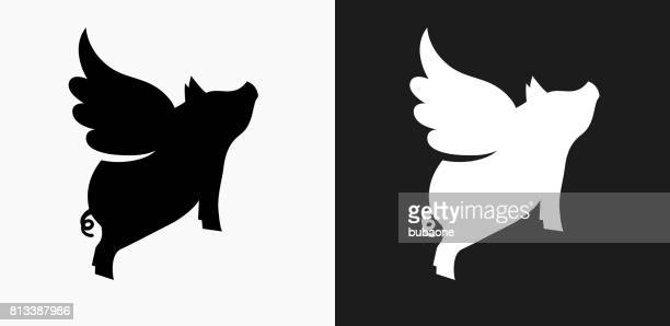 flying pig icon on black and white vector backgrounds - pig stock illustrations