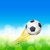 flying soccer ball over green and blue landscape with glittering particles. football theme vector illustration