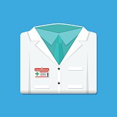 Folded doctors lab white coat with badge