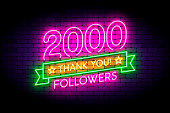 2000 followers neon sign on the wall.