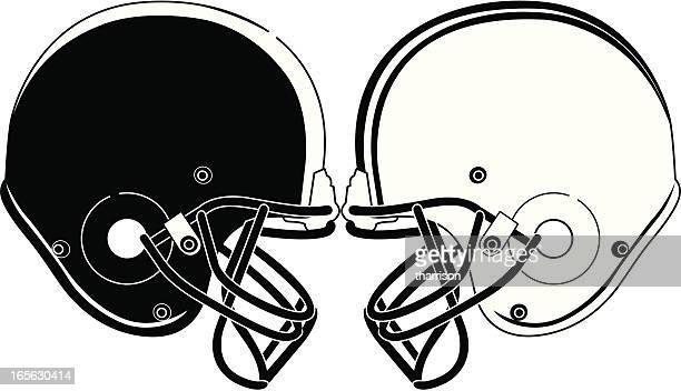 football helmets smashing bw - football helmet stock illustrations