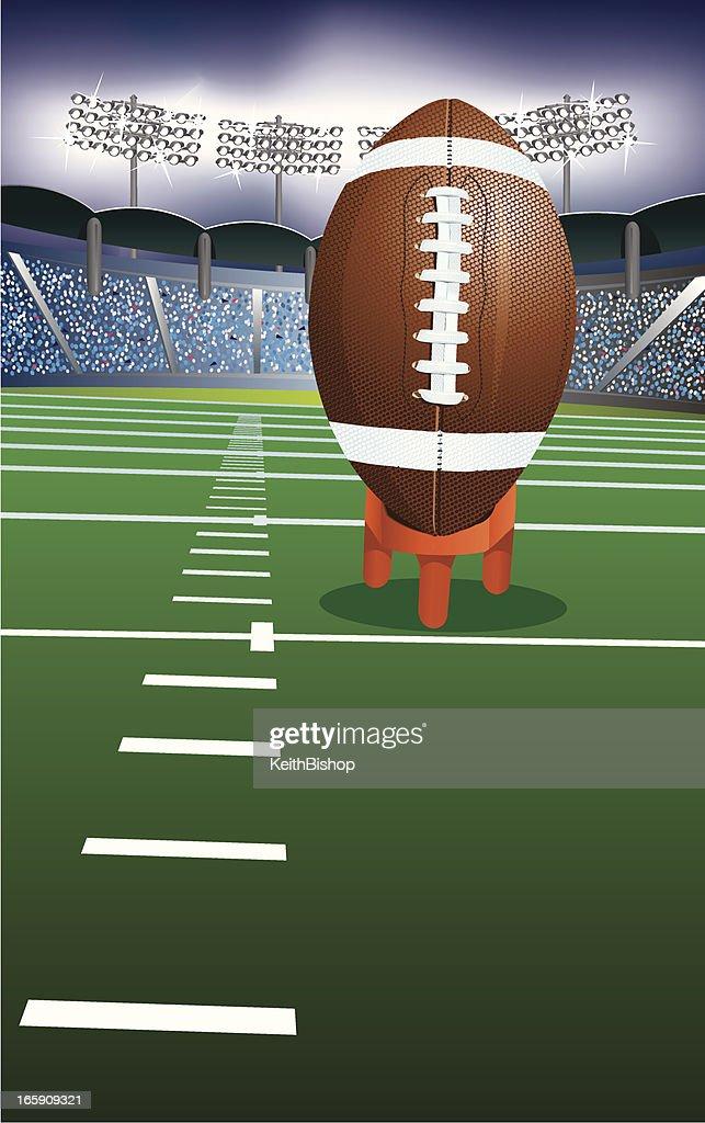 Football Kick Off Under Stadium Lights