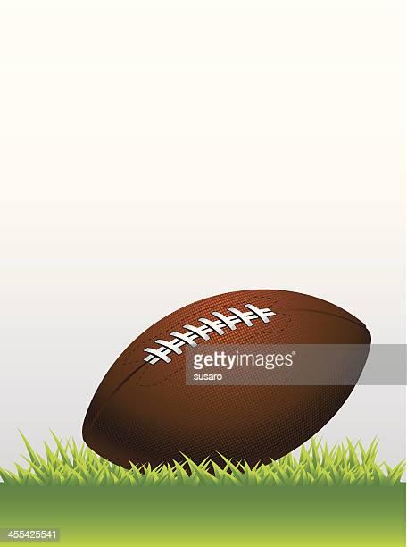 football on grass background - american football ball stock illustrations