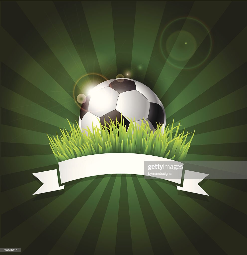 Football soccer ball on grass with white ribbon