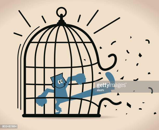 Forbidden and freedom, businessman breaking out the large birdcage (cage)