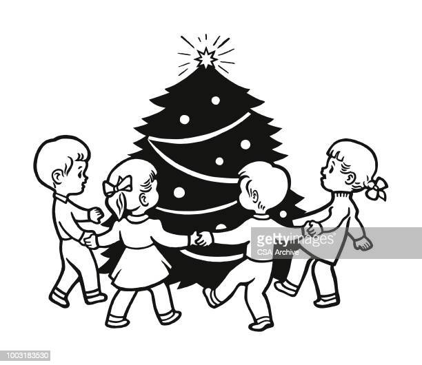 Four Children Playing Around a Christmas Tree