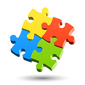 Four colored jigsaw pieces fit together on a white backing