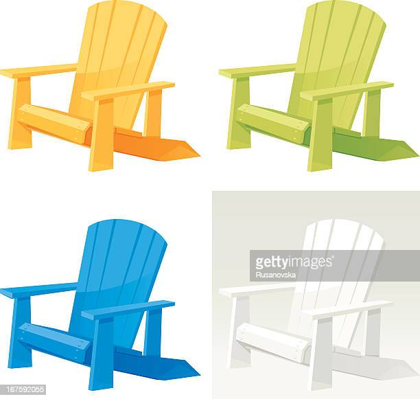 Four colorful muskoka Adirondack armchairs on white back