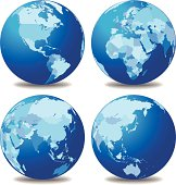 Four globes with different continents