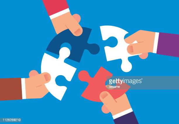 four hands holding a puzzle - co ordination stock illustrations