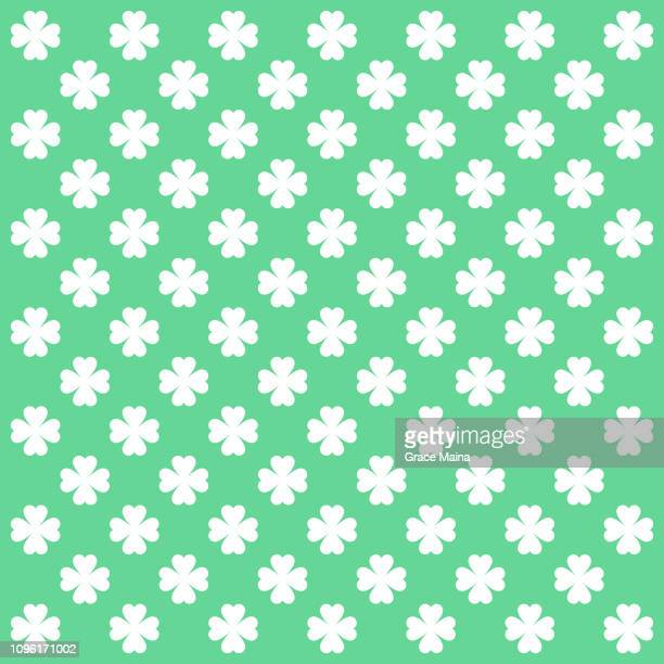 four leaf clover repeating pattern on green background - four leaf clover stock illustrations