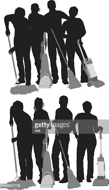 Four people cleaning floor