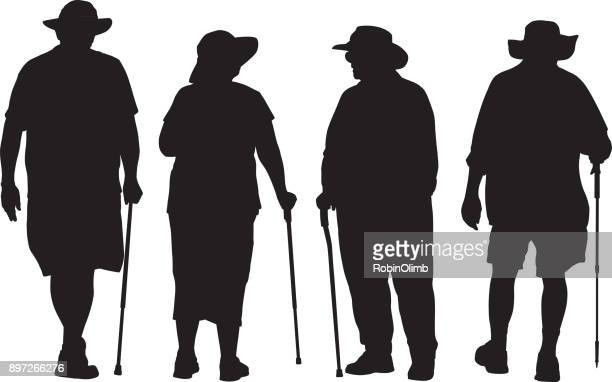Four Seniors With Walking Canes