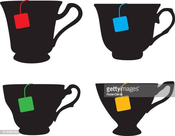 Four Teacups With Teabags.