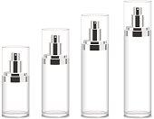 Four transparent cosmetic bottles
